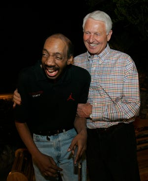 Former Arizona coach Lute Olson, right, shares a moment with his former player, Kenny Arnold, in Tucson, Arizona, in 2005. Olson and the rest of the team raised money to help pay for Arnold's medical expenses.