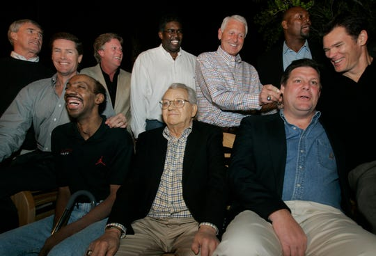 Members of the 1980 Iowa Final Four team joke around before having their picture taken at former Arizona coach Lute Olson's home in Tucson, Arizona, in 2005. Kenny Arnold is bottom left.