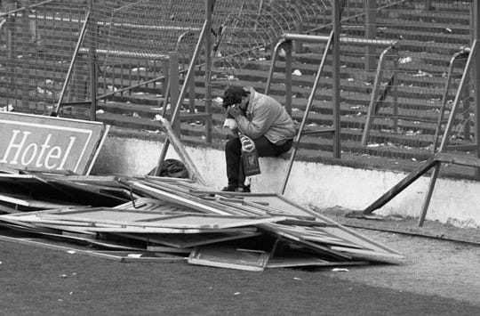 File photo dated 15/04/89 of a distraught young Liverpool fan, after 96 fans were crushed to death at Hillsborough during an FA Cup semi-final between Nottingham Forrest and Liverpool.