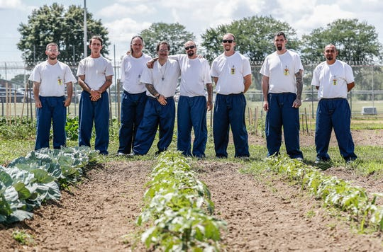 Men taking part in an offender gardening program inside the Plainfield Correctional Facility are photographed in the vegetable garden, on Thursday, July 11, 2019. This is the second year for the program, which has so far donated 395 pounds of vegetables grown by the offenders to community churches and other institutions.