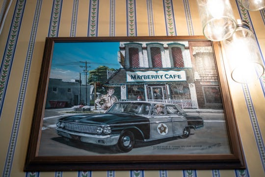 Photos and memorabilia from The Andy Griffith Show hang on the wall of Mayberry Cafe in Danville, Ind., on Wednesday, July 3, 2019.