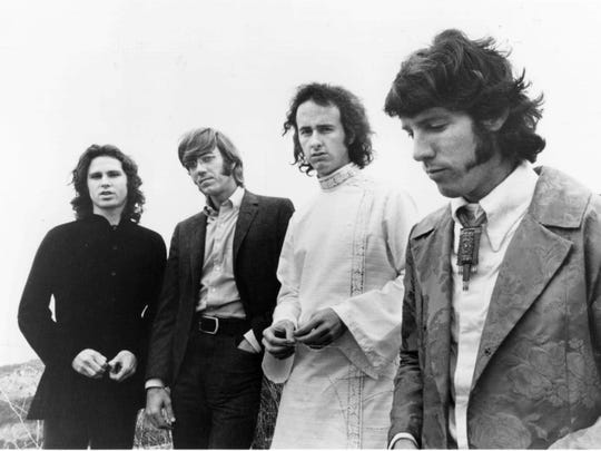 The Doors (from left, Jim Morrison, Ray Manzarek, Robbie Krieger and John Denismore) became Rock and Roll Hall of Fame inductees in 1993.
