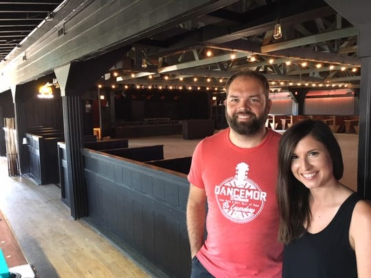 Nick and Rebekah Neuendorf of Swisher are prepared for their second season as owners of the town's historic DanceMor ballroom. This dance floor and stage has changed little in its nine decades of existence.