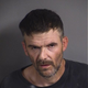 North Liberty man faces assault, carrying weapon charges