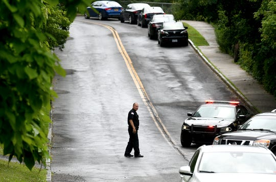 A member of the Tompkins County Sheriff's Office redirects traffic as law enforcement agencies continue investigating a Wednesday morning homicide on Lake Street in Ithaca. July 17, 2019.