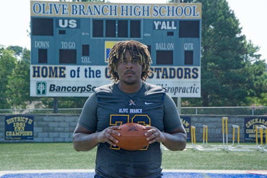 Xavier Hill on the football field of Olive Branch High School during a summer practice.