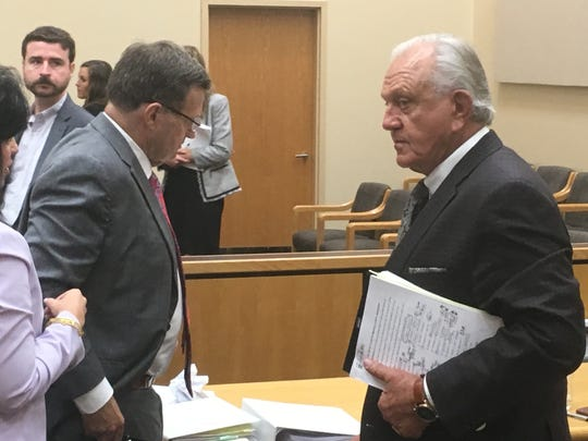 Former Mississippi State University head coach Jackie Sherrill, right, stands up from the plaintiff's table upon conclusion of the first day of trial on July 15, 2019, in Madison County Circuit Court in Canton. Sherrill is suing the NCAA in a case dating back to 2004.