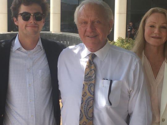 Former MSU coach Jackie Sherrill (middle) breathes a sigh of relief Wednesday afternoon after reaching a settlement with the NCAA on July 17, 2019. Standing next to him is his grandson, Daniel Morse, and his wife, Peggie Sherrill.