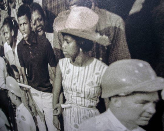 In 1963, Dorothy Pitchford, center, marched on Capitol Street in Jackson as part of the Jackson sit in protesting for the right to vote.