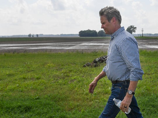 Governor Bill Lee walks back to the helicopter after touring farm land in West Tennessee and speaking with farmers at Dyersburg Regional Airport, Wednesday, July 17. Lee ended his tour after talking to Alan Meadows. Meadows' soybean farm has been affected by flood waters.
