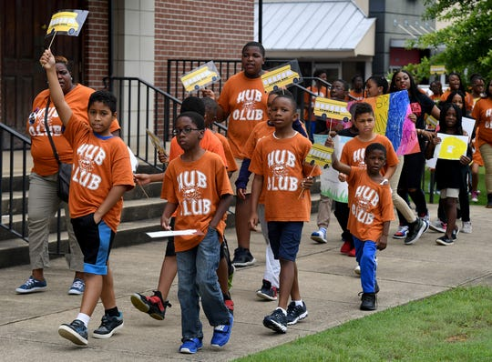 Freedom School students march around Mother Liberty CME Church to bring awareness to gun violence in the country, Wednesday, July 17.