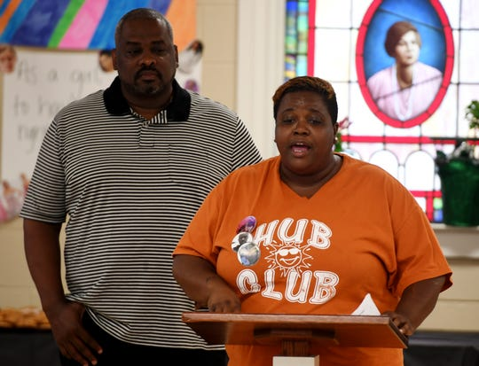 Jackson City Councilman Johnny Dodd stands behind Tanya Rivers during the Freedom School National Day of Social Action event, Wednesday, July 17, at Mother Liberty CME Church. Rivers lost her son, James, in an accidental shooting in Jackson.