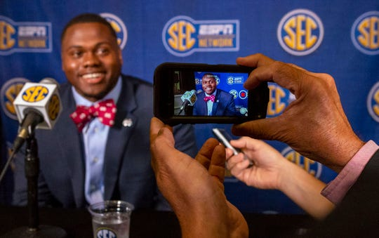Mississippi State Bulldogs linebacker Erroll Thompson is photographed on a cell phone as he speaks with the media during SEC Media Days at the Hyatt Regency-Birmingham.