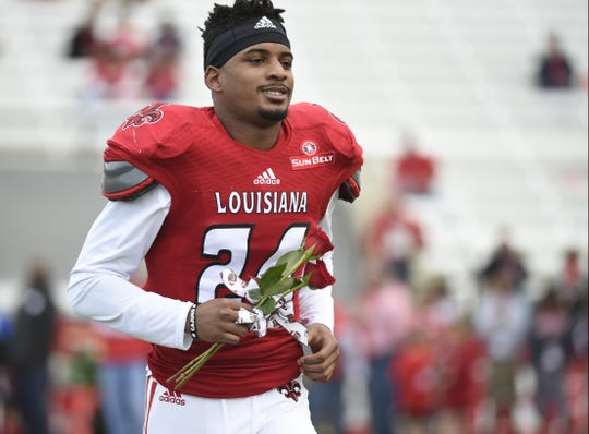 UL defensive back Sean Thomas takes the field for Senior Day in 2014. Thomas died in a vehicle accident Wednesday.