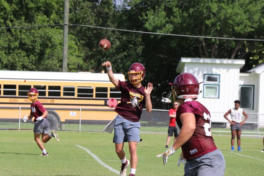Iota High School quarterback Dawson Wallace throws a pass during practice Wednesday. The Bulldogs are placing their faith and confidence in the sophomore as they prepare to follow up their undefeated regular season in 2018.