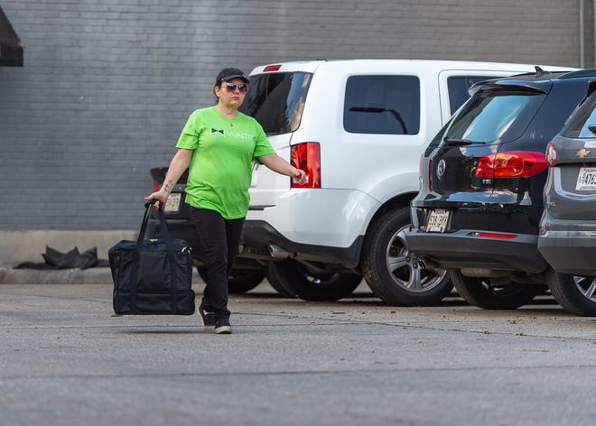 A Waitr delivery driver picks up an order at local restaurant in Lafayette  Wednesday, July 17, 2019.