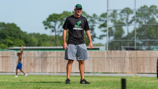 Lafayette Mighty Lions Head Football Coach Rob Pool during summer workouts at Lafayette High School in Lafayette, La., Thursday, June 27, 2019.