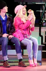 Elle Woods, portrayed by Eryn Hollobaugh, talks to her dog Bruiser Tuesday, July 16, 2019, during a dress rehearsal for Legally Blonde: The Musical at Ohio University Lancaster.