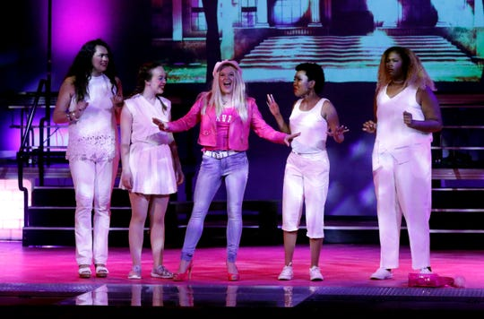 Elle Woods, center, portrayed by Eryn Hollobaugh, stops her friends Margot, left, portrayed by Stephanie Colby, Serena, second from left, portrayed by Katie Maccabee, Pilar, second from right, portrayed by Laura Overby and ensemble member Lia Graham, right, Tuesday night, July 16, 2019, during a dress rehearsal for Legally Blonde: The Musical at Ohio University Lancaster.