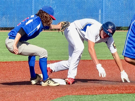 Lancaster Post 11's Tylor Wolfe slides safely into second on a stolen base Tuesday against Cambridge Post 84 at Beavers Field.