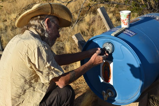 Joel Smith of Humane Borders checks a water drum in the Sonora Desert.