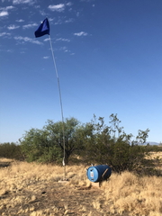 Humane Borders plants flags to mark water drums spread across the Sonora Desert.
