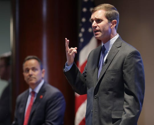 Attorney General Andy Beshear makes remarks on the state budget during a debate with Governor Matt Bevin at Kentucky Farm Bureau on Wednesday morning.
