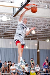 Joey Hauser dunks in the Moneyball Pro-Am, July 16 at Aim High in Dimondale.