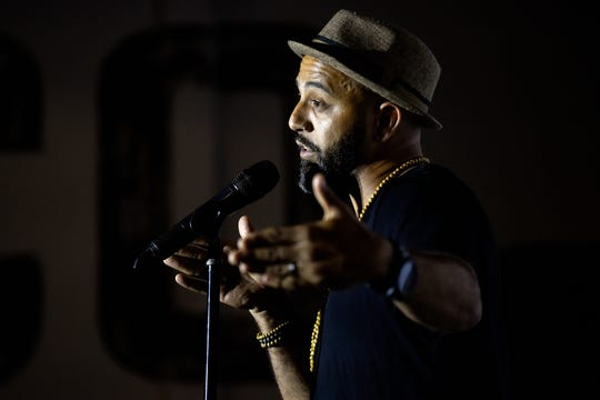 Ozay Moore speaks on stage during the Lansing Storytellers Project: 'Growing Pains' event on Tuesday, July 16, 2019, at the Lansing Brewing Company.