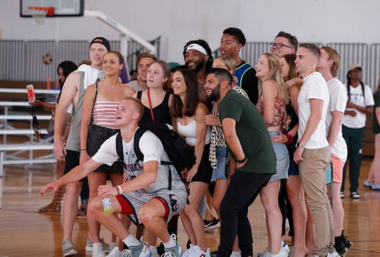 Team Dimension's Joey Hauser poses for a photo with fans following the Moneyball Pro-Am, Tuesday, July 16, 2019, at Aim High in Dimondale, Mich.