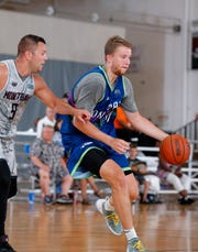 Team Cosmic's Thomas Kithier, right, drives against Team Dimension's Bryon Dutton in the Moneyball Pro-Am, Tuesday, July 16, 2019, at Aim High in Dimondale, Mich.