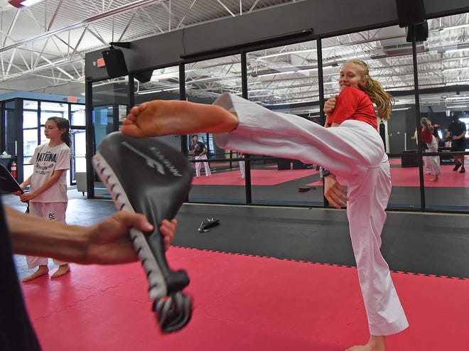 Taekwondo star Natalie Hershberger, ranked No. 1 in the country in her weight class, kicks during practice at Black Belt Pro Fitness.