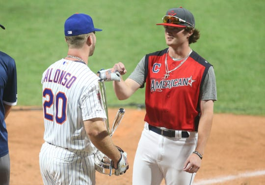 National League first baseman Pete Alonso (20) of the New York Mets congratulates Blaze Jordan of Desoto Central High School in Southhaven MS after the 2019 MLB Home Run Derby in Cleveland on July 8, 2019.