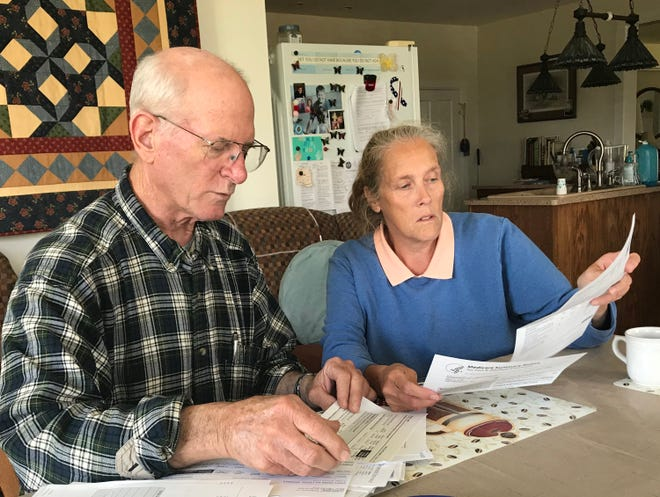 Tom Leith and his wife, Kathy, look over his medical records. Leith, 64, who lives near Lake Geneva, was diagnosed with rheumatoid arthritis in 1983 and was told he eventually would need a wheelchair. Thanks to a variety of drugs, including biologic medicines, he has continued to walk without the need for a wheelchair.