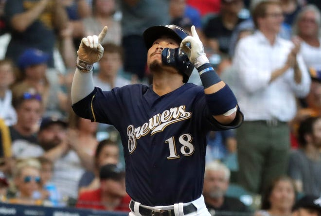 Brewers rookie Keston Hiura points to the heavens after his solo homer aginst the Braves in the second inning.