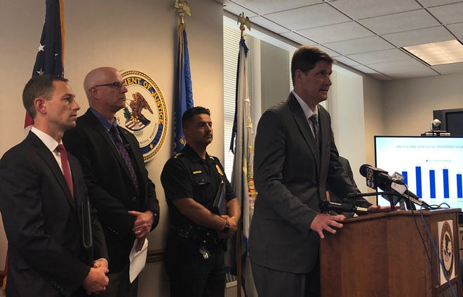 Milwaukee County District Attorney John Chisholm speaks Tuesday at a news conference after officers arrested 15 people in what federal prosecutors said was a drug and gun trafficking ring. Joined by Chisholm were (from left) Matthew Krueger, U.S. attorney for the Eastern District of Wisconsin; Gregory Connor, acting assistant special agent in charge for the DEA in Milwaukee; Milwaukee Police Chief Alfonso Morales and multiple other heads of law enforcement agencies from the area.
