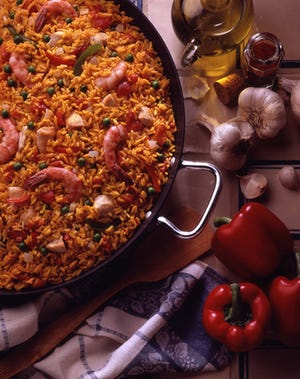 Paella, the one-pot Spanish classic, can be made in a cast-iron skillet, as a cooking class at Shully's Cuisine & Events in Thiensville will show.