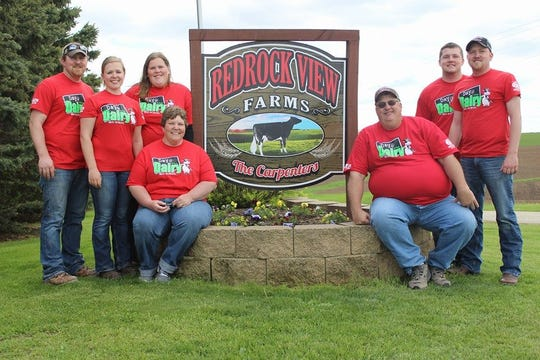 The Carpenter family of Redrock View Farms poses for a picture. Like a vast majority of Wisconsin dairy farms, Redrock is family-owned, and everyone is pitching in to keep their cattle comfortable during this week's intense heat.