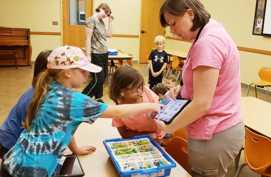 Children learned programming skills using Legos during the Baxter County Library's Robotics Class with Instructor Sara.