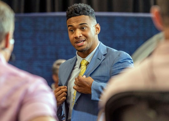 Jul 17, 2019; Birmingham, AL, USA; Alabama Crimson Tide quarterback Tua Tagovailoa talks with ESPN during SEC Media Days at the Hyatt Regency-Birmingham. Mandatory Credit: Vasha Hunt-USA TODAY Sports