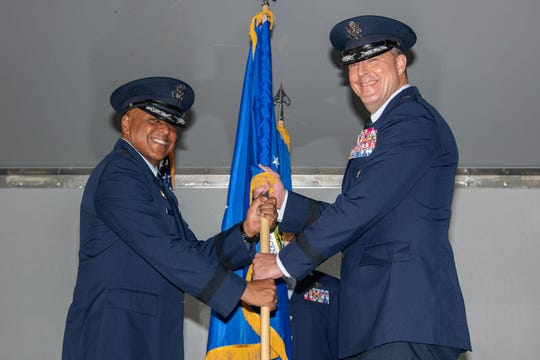 Lieutenant Gen. Anthony Cotton, Air University commander, presents the unit flag for the Curtis E. LeMay Center for Doctrine Development and Education to Maj. Gen. Brad Sullivan, who took command of the center on July 15, 2019, at a change of command ceremony on Maxwell Air Force Base, Alabama.