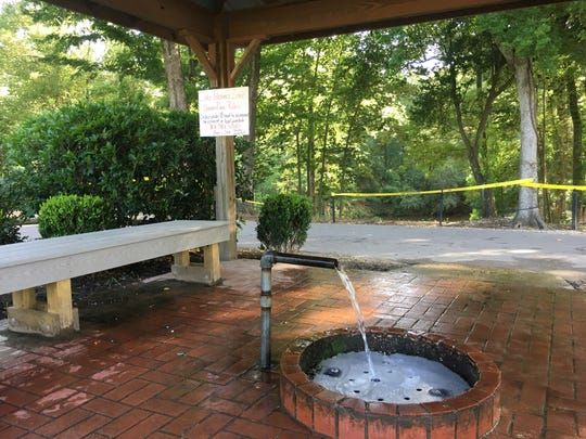 Doster well flows from a pipe under cover of the pavilion.