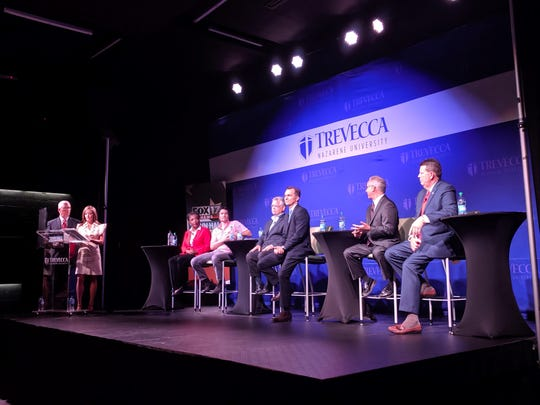 Six mayoral candidates discussed issues including traffic and economic growth at a town hall Tuesday.