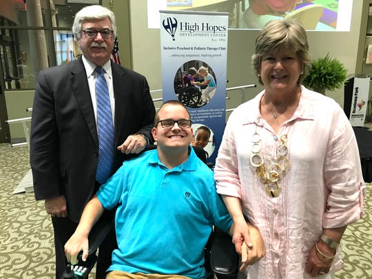 """Bob and Karen Sircy, founders of High Hopes Development Center, stand with Barrett Patton, a """"success story"""" of the center, which serves children with special needs."""