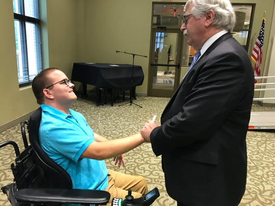 Co-founder of High Hopes Development Center Bob Sircy (right) thanks Barrett Patton, 20, for delivering a memorable speech at the center's 35th anniversary breakfast Wednesday. Patton, a junior at University of Illinois, has received services from High Hopes for most of his life.