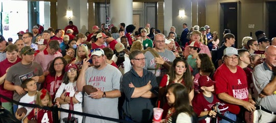 Alabama fans wait for coach Nick Saban and players to appear in Hyatt Regency lobby at the 2019 SEC Media Days in Birmingham, Alabama.