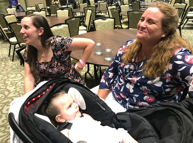 High Hopes Development Director Brandy Blanton sits with her daughter Samantha Castro and granddaughter Elliott Grace Castro, 4, who has a rare genetic disorder.