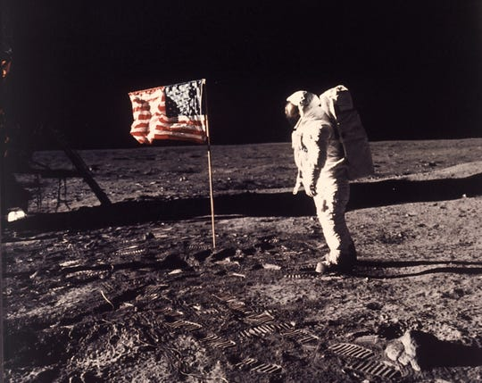 Astronaut Buzz Aldrin is seen posing for a photograph beside the U.S. flag deployed on the moon during the Apollo 11 mission on July 20, 1969.