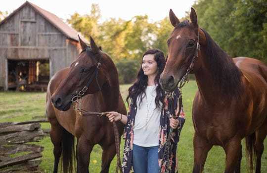 Licking Valley 2019 graduate Michayla Schmitt posed for her senior picture with her horses Zanes Zimba and Shudabens Leader.