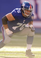 In this 2011 photo, the New York Giants guard Chris Snee (76) on the line during Sunday's 23-10 loss to the Washington Redskins at MetLife Stadium.